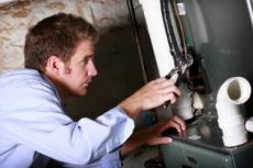 our tech Jim is doing a water heater repair in Greenbelt, MD